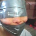 woman duct tapes child's face